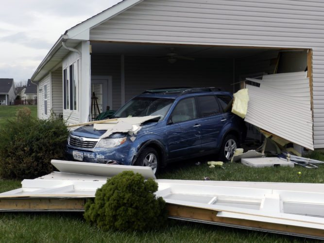 A vehicle rests inside the Stone Hall Community Center at Autumn Glen retirement subdivision near Stephens City on Tuesday. Police said the driver mistook the gas pedal for the brake and her car jumped the curb and crashed through the center's eastern wing.  Henry Culvyhouse/Daily